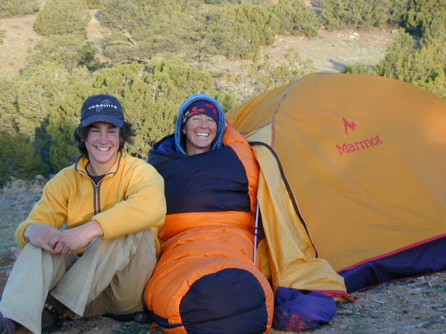 Morning smiles in the desert with tent and sleeping bag