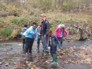 Holly with 5th graders looking for macro invertebrates.