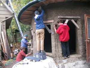 building a straw-earth home--a favorite, if dirty, service learning experience